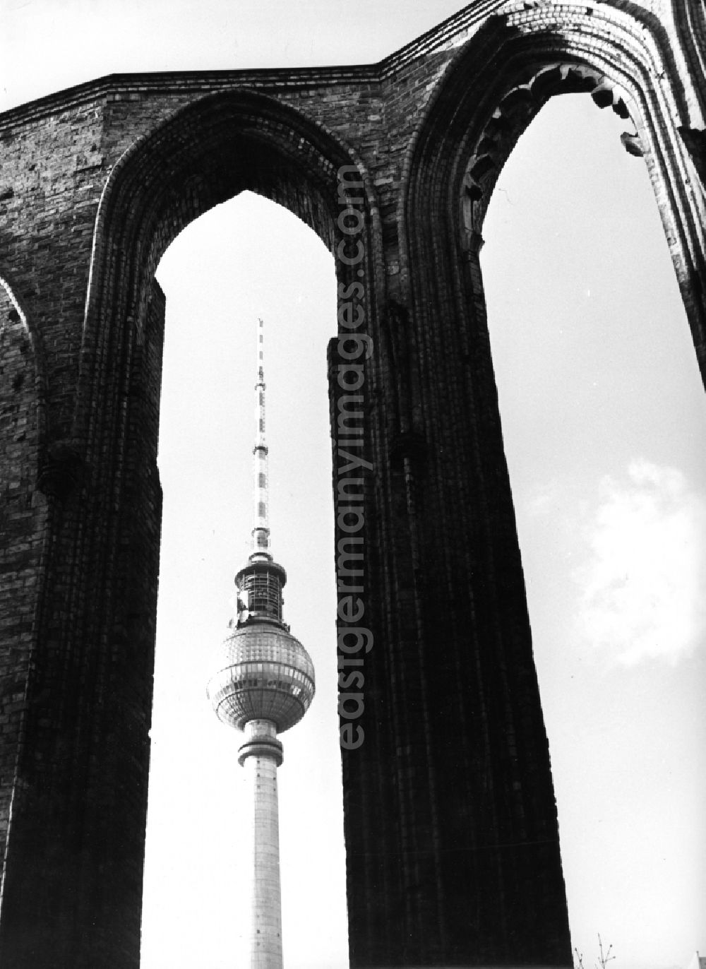 GDR photo archive: Berlin - Ruins - rest of the facade silhouette and roof structure of the sacral building of the Franciscan monastery church on Klosterstrasse against the silhouette of the Berlin TV tower in the Mitte district of Berlin, the former capital of the GDR, German Democratic Republic