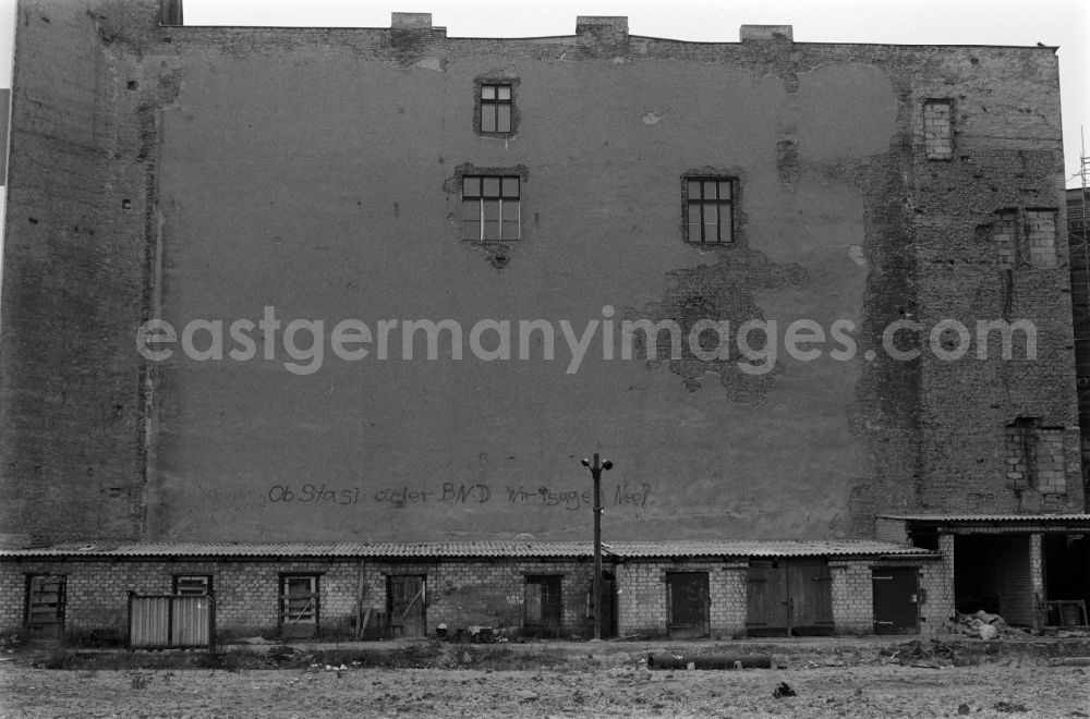 GDR picture archive: Berlin - The words Stasi or BND, we say no are on a house facade in Berlin - Mitte, the former capital of the GDR, German Democratic Republic