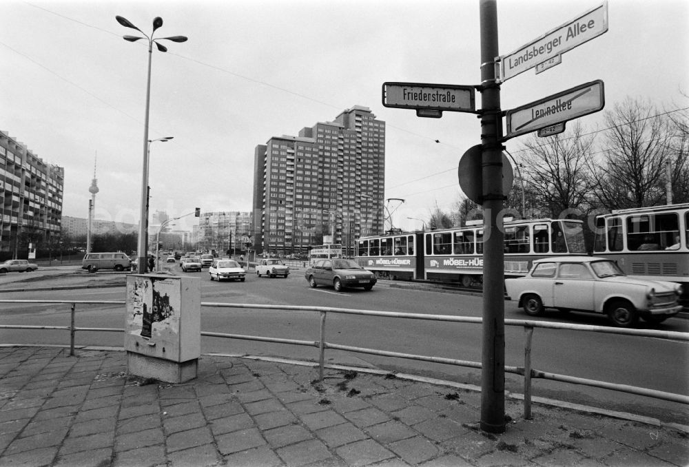 GDR image archive: Berlin - A new street sign shows the renaming of Leninallee in Landsberger Allee on the corner Friedenstrasse in Berlin - Friedrichshain, the former capital of the GDR, German Democratic Republic.