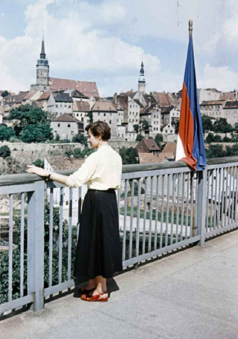 Woman on bridge on historic old town in the center in Bautzen in the state Saxony on the territory of the former GDR, German Democratic Republic