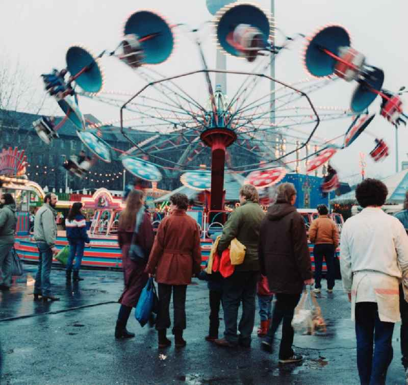 Rides and visitors at the Christmas Market in Berlin, the former capital of the GDR, German Democratic Republic.