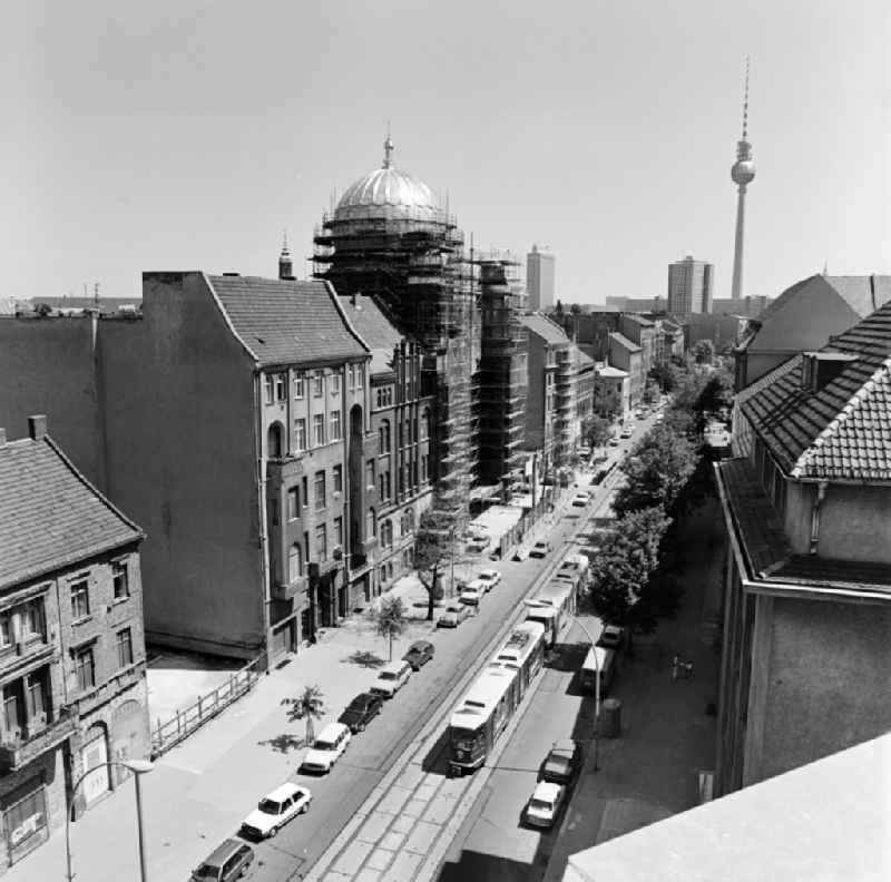 View of the Oranienburger Strasse towards the city center with New Synagogue during the construction works and TV tower in the background in Berlin - Mitte, the former capital of the GDR, German Democratic Republic.