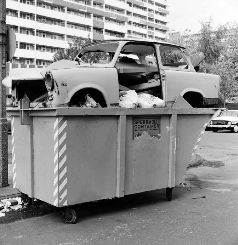 A Trabant was disposed of in a bulky waste container on the side of a road in Berlin - Mitte