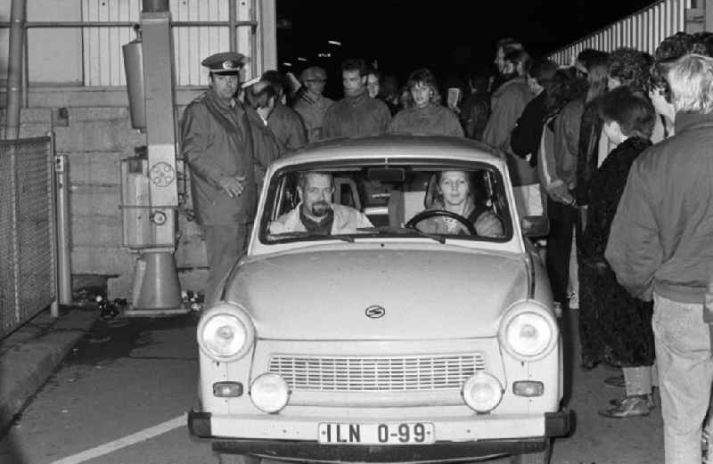 On the evening of the fall of the Berlin Wall, a Trabant car drives from East Berlin to West Berlin at the border crossing point Invalidenstrasse in the district Mitte in Berlin, the former capital of the GDR, German Democratic Republic