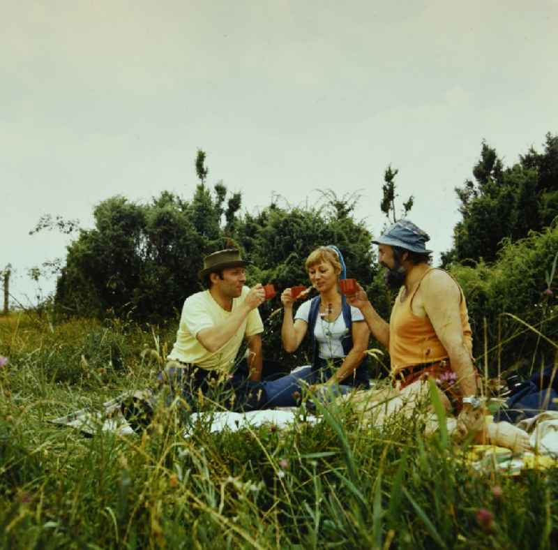 Camping enthusiasts during a picnic in a meadow in Boek in the state Mecklenburg-Western Pomerania on the territory of the former GDR, German Democratic Republic