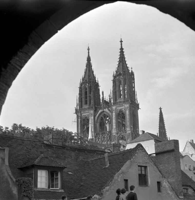 View of the baroque bell towers of the Cathedral of Magdeburg in Saxony - Anhalt. Photographed by an archway